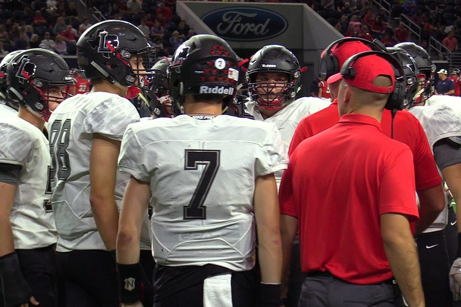 Ready+to+take+the+field+at+the+Ford+Center%2C+the+offense+huddles+on+the+sideline+during+Thursday%27s+game+against+Centennial.+Falling+behind+35-0+in+the+first+half%2C+the+Redhawks+outscored+the+Titans+21-7+after+the+break%2C+but+it+wasn%27t+enough+as+the+team+lost+its+third+straight+District+5-5A+game+42-21.