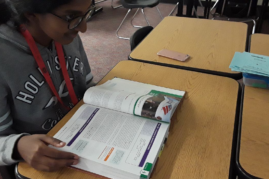 As textbooks are becoming a thing of the past, some teachers hold onto the old method of teaching while others have been more technologically focused. Senior Ramya Rajendran continues to utilizes her economics textbook in class.