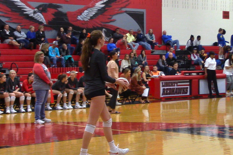 Senior Sophie Thompson steps up to the serving line.