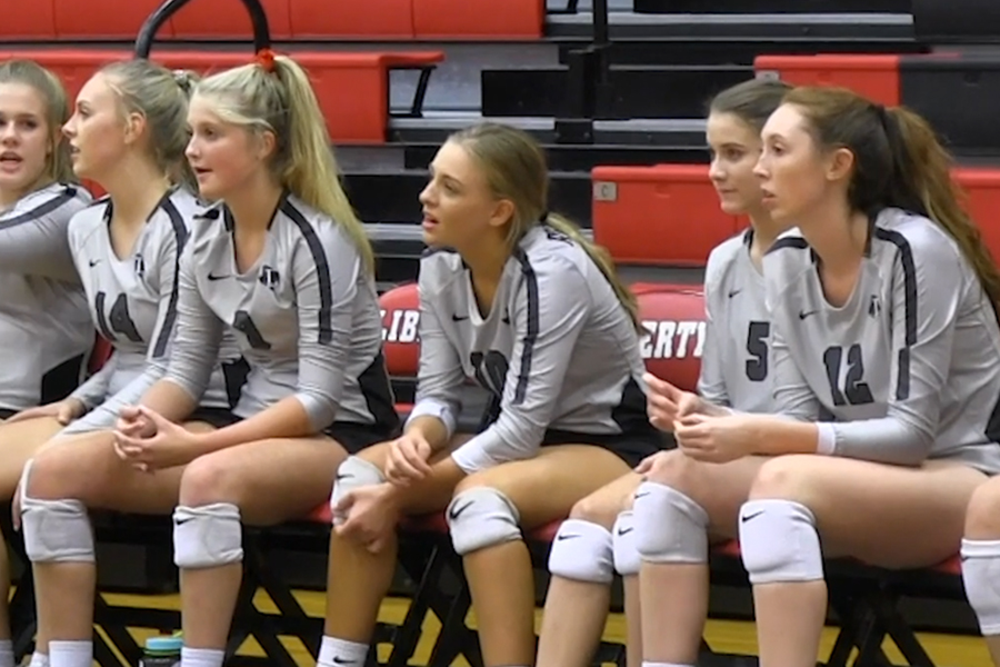 Watching from the sideline, members of the Redhawks watch the rest of the team at Tuesday's home match against Lone Star. Beating the Rangers 3-0, the team has won 13 straight games and leads District 9-5A with a 13-1 record.