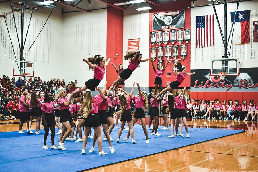 Performing+one+of+several+stunts+during+the+Pink+Out+Pep+Rally%2C+cheerleaders+are+launched+into+the+sky+as+several+of+their+teammates+wait+to+catch+them.+With+the+addition+of+a+cheer+class%2C+cheerleaders+would+have+much+more+time+to+rehearse+for+pep+rallies+and+competitions+as+well+as+receiving+a+fine+arts+credit.