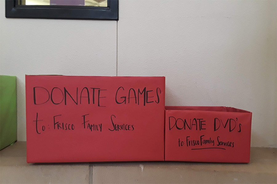 There are boxes in the rotunda for students to drop off games and DVDs for Frisco Family Services. The drive will continue until November 14th.