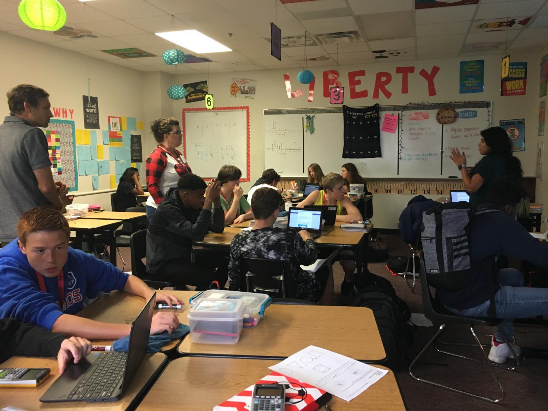 Statistics teacher Evan McGee observes geometry teacher Maria Delgado's classroom as they do an assignment on the Chromebooks