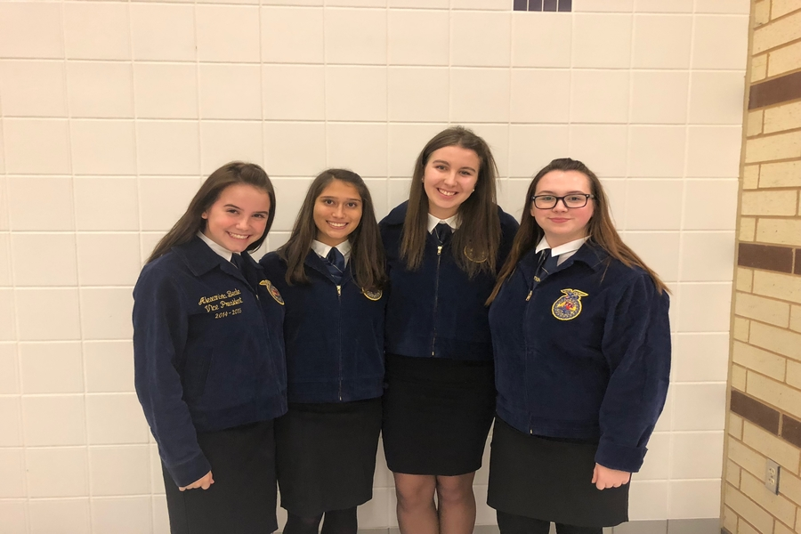 Sophomore Rachel Wilson, sophomore Thais Fernandez, senior Sophia Garofalo, and sophomore Olivia Christian (left to right) claimed first in the Future Farmers of America Public Relations competitions on Tuesday at Anna High School.