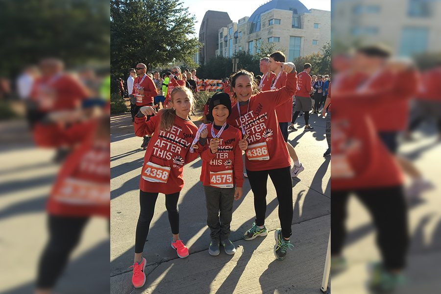 Senior Katharina Santos (right) poses with her siblings following the Turkey Trot.