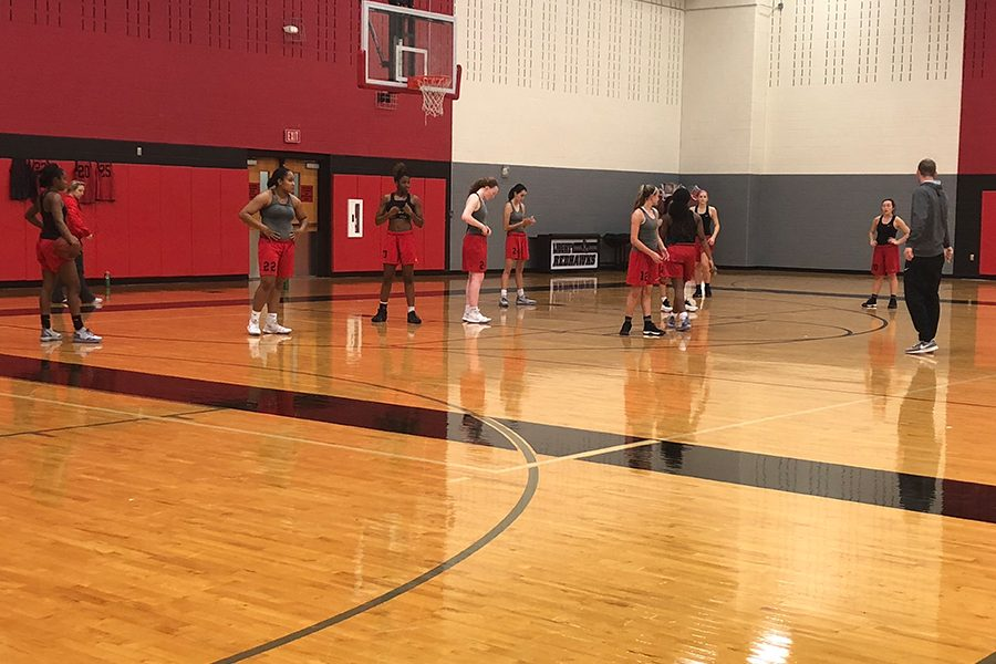 Pointing+to+a+spot+on+the+court%2C+girls%27+head+basketball+coach+Ross+Reedy+explains+a+concept+during+a+recent+practice.+The+girls%27+team+is+back+in+action+Tuesday+night+as+they+travel+west+to+take+on+Frisco+High+School+starting+at+6%3A00+p.m.+The+team+enters+the+game+with+a+2-0+record+in+District+9-5A.+