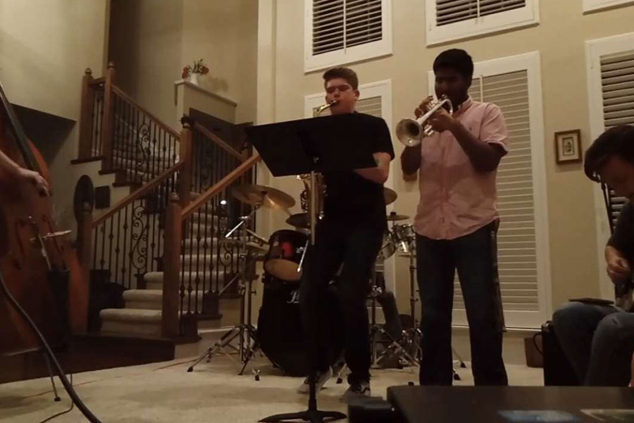 As+a+member+of+his+own+jazz+group%2C+called+the+Jazzheads%2C+trumpet+player+Sid+Sadhu+practices+with+2018+graduate+Nathan+Brooks%2C+an+alto+saxophonist.+
