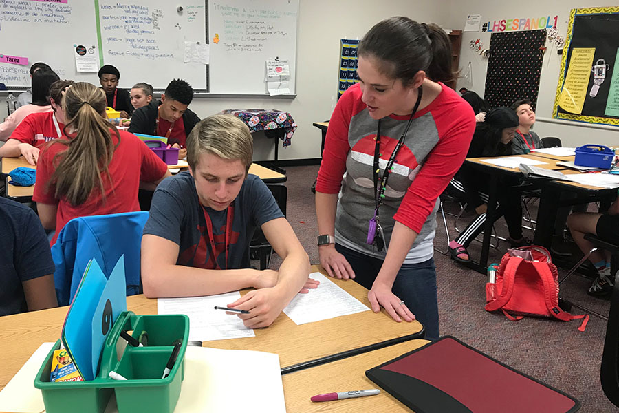 Allowing students such as sophomore Carson Connor to have say in how their class will operate, Spanish I teacher Kristen Kubic works with Connor during class on Monday, Dec. 17, 2018.