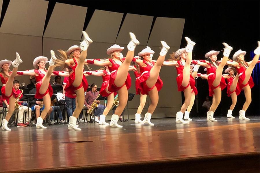 Kicking their legs high in the air, the Red Rhythm dance team practices their Winter Extravaganza performance in the auditorium. Along with Red Rhythm, band, orchestra, choir, and other fine arts groups will be performing Tuesday and Wednesday starting at 7 p.m.