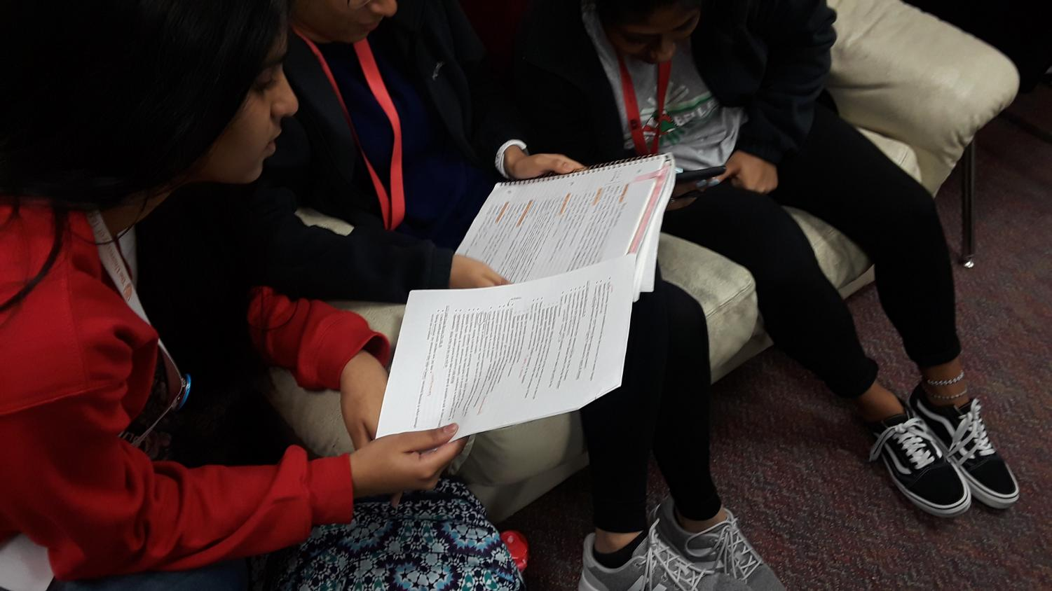 Studying for their DECA District CDC test, seniors Grishma Geedipally, Maahi Patel and Rishika Macha look over their notes. The test being administered is used to determine whether or not competitors advance to the state competition.