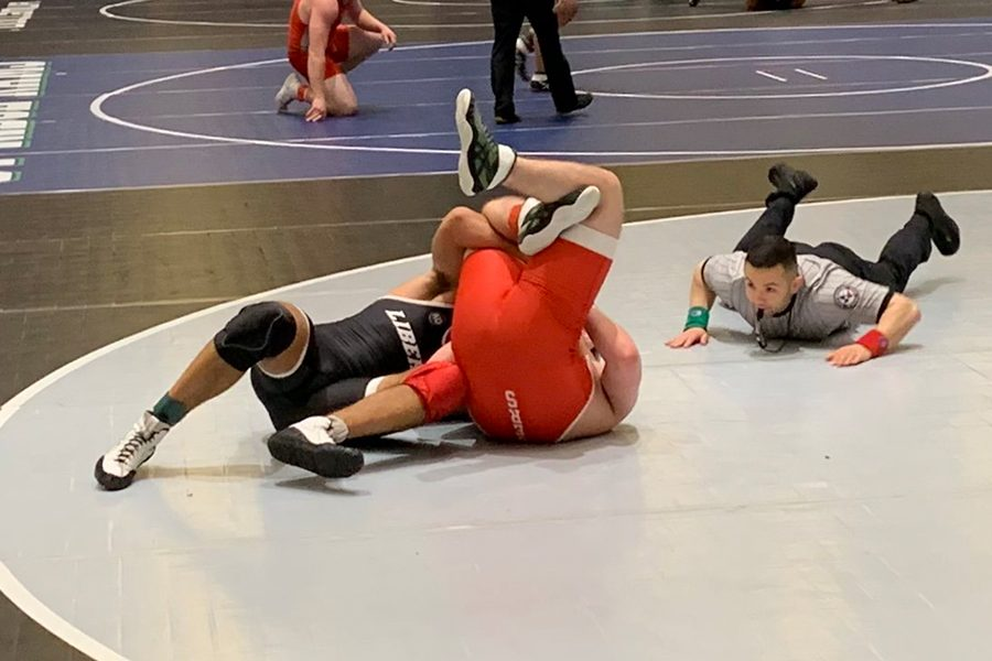 Holding+his+opponent+in+a+cradle%2C+senior+Diego+Lorenso+gets+the+pin+which+advanced+him+to+the+round+of+16+at+the+17th+annual+Cy+Fair+tournament.+Wrestling+at+195+lbs.%2C+Lorenso+won+all+five+his+matches+to+claim+the+championship+which+included+several+wins+over+top+ranked+6A+wrestlers.+