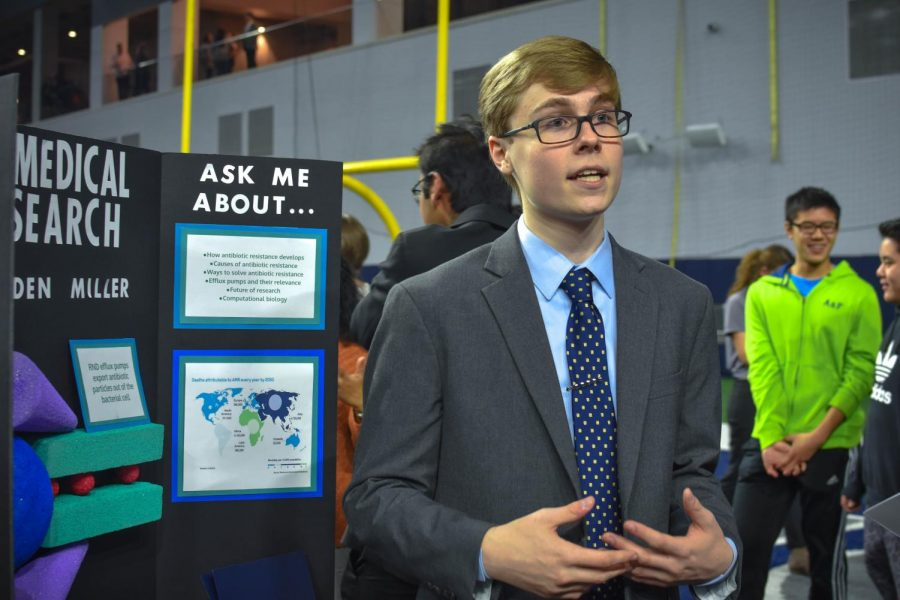 Senior Brayden Miller answers questions about his original work as he studies medical research this year at ISM.