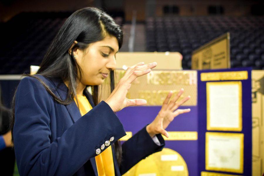 Senior Kanika Kappalayil explains her original work at Wednesday's showcase as she prepares to begin work towards her final product.