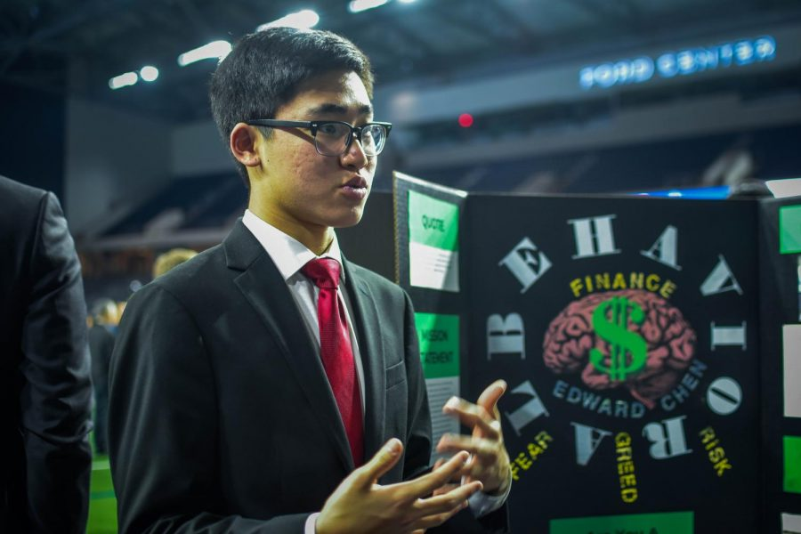 Conversing with attendees, senior Edward Chen describes the progress of his project as ISM brings him into the world of finance.