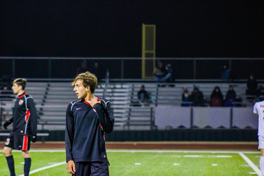 Junior John Keene looks onto the field as the Redhawks take on the Wolverines on Tuesday January 15th at home.