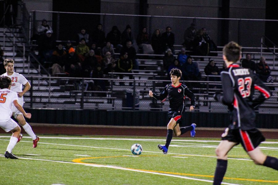 Senior Justin Parri dribbles the ball down the field against the Wolverines on Tuesday, January 15th at home.