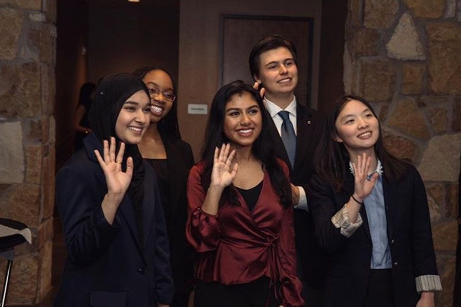 Senior Amina Syeda and Elaine Mei pose with other recepients of the Dr. Martin Luther King Jr. scholarship awarded by Linking Cultures of Frisco. Both Mei and Syeda had to display their oratory skills at the9th annual Dr. Martin Luther King Jr. Oration contest.