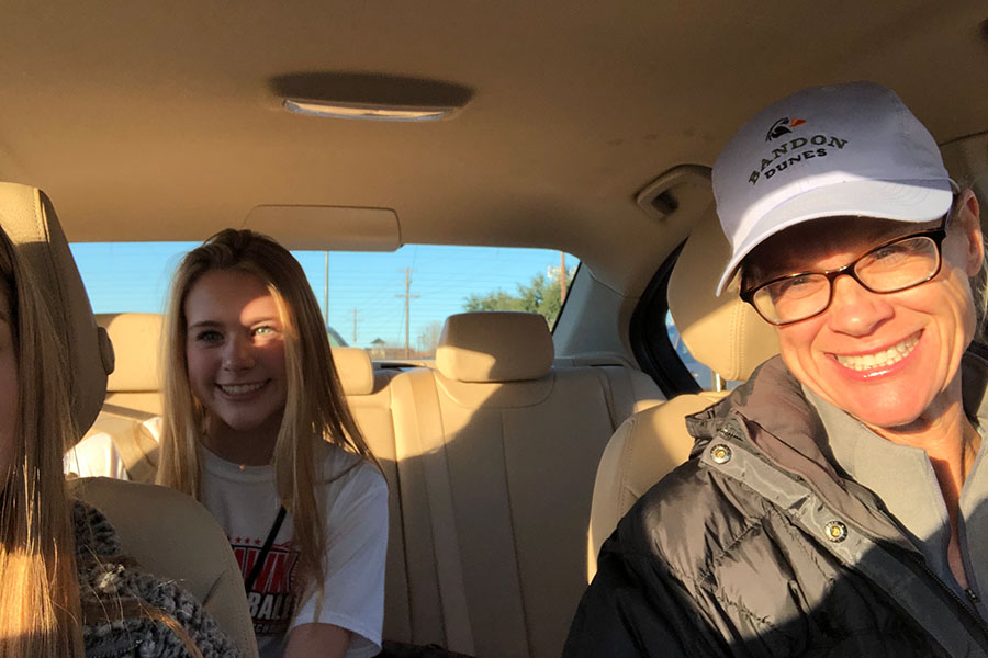 Waiting for her chance to take the wheel, freshman Allie Lynn sits in the backseat behind mom Colleen Lynn driving home for school. Wingspan's Allie Lynn shares her thoughts on being a 15 year old in high school.