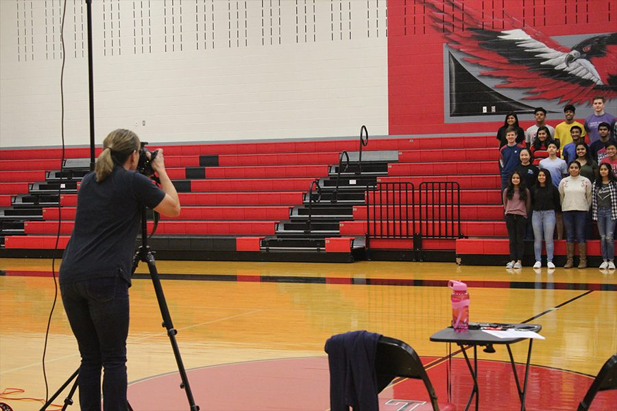 Stationed at center court, photographer Amy Smith took multiple pictures of each group on Wednesday, Jan. 16, 2019.