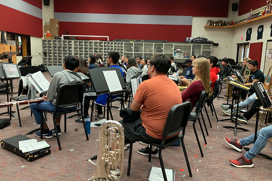 "Straying from the norm of playing instruments, orchestra students are learning by singing.  ""We started singing at the beginning of every class to help develop students' hearing ability,"" assistant director Victoria Lien said."
