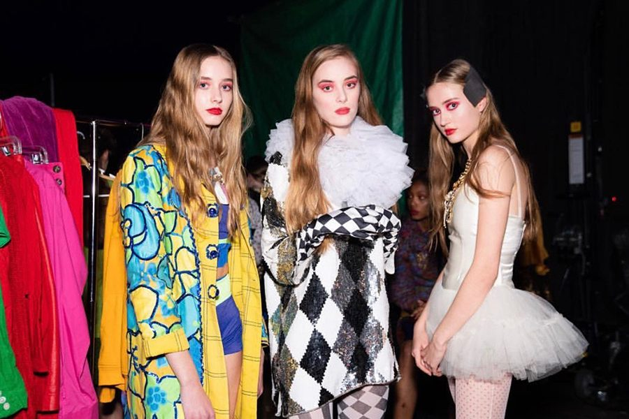 Posing+with+fellow+models%2C+junior+Elissa+Williams+hopes+to+further+pursue+modeling++into+the+future+and+eventually+move+to+New+York+with+other+models.