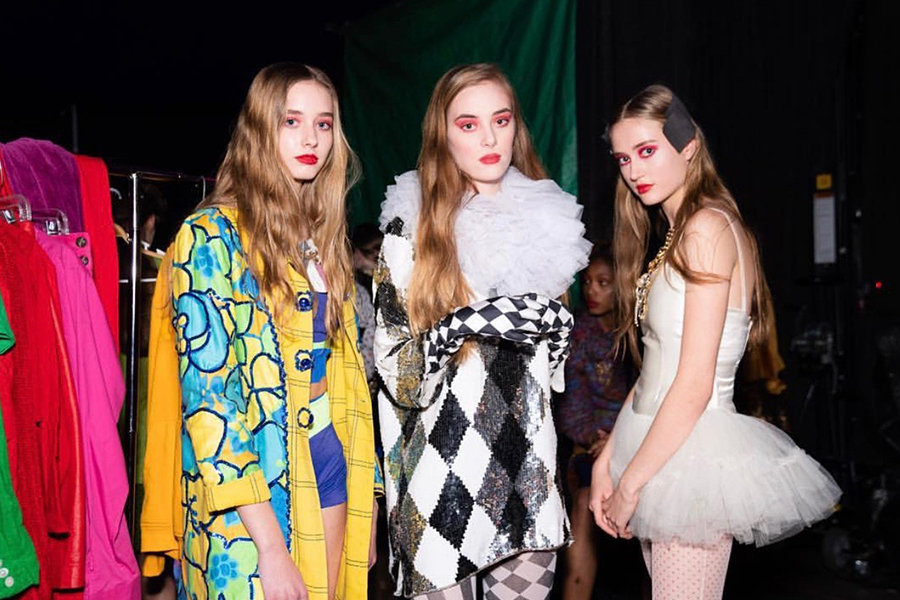 Posing with fellow models, junior Elissa Williams hopes to further pursue modeling  into the future and eventually move to New York with other models.