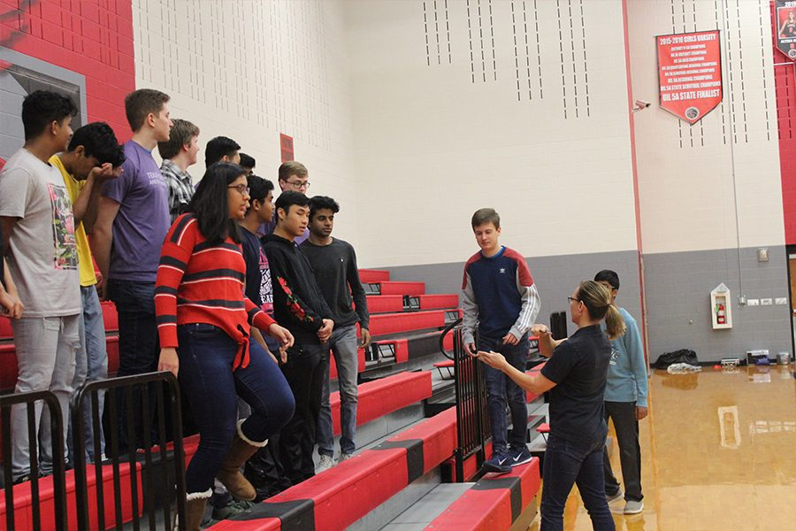 Lining up students on the visiting side bleachers in the main gym, photographer Amy Smith spent Wednesday working with the dozens of clubs on campus for yearbook picture day.
