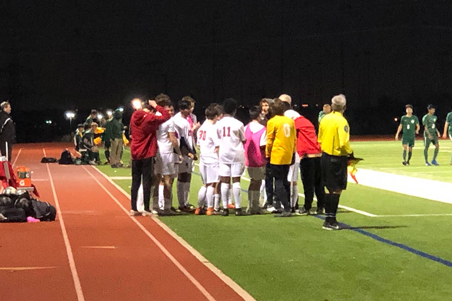 Boys' soccer huddles on the sideline in the game against the Reedy Lions on Friday, Jan. 18. The Redhawks are back in action Friday against Independence on Friday, Feb. 1, 2019 as they go for their first District 9-5A win.