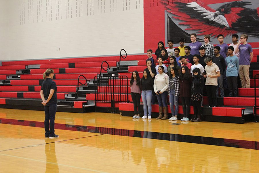 Once each group was in the stands, photographer Amy Smith made sure the spacing between students was right while also making sure each group posed in the same way.