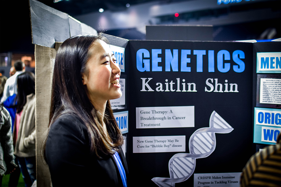 Studying+gene+therapy+this+year%2C+senior+Kaitlin+Shin+smiles+as+she+discusses+her+original+work+with+attendees.