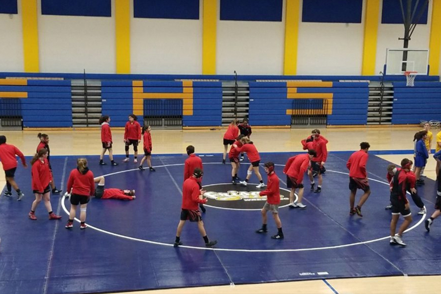 A UIL rule limiting the amount of time a wrestler can compete is allowing JV wrestlers to experience varsity competition on Thursday as the Redhawks take on Wakeland and Lebanon Trail at Frisco High School.