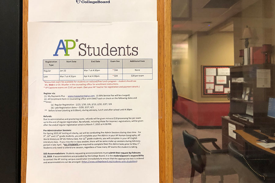 An AP registration form hangs on the door of the counselors' office where students can pay in check to avoid an online service charge. Students singing up after March 7 can still register by April 4 but for a late charge of $20 per exam.