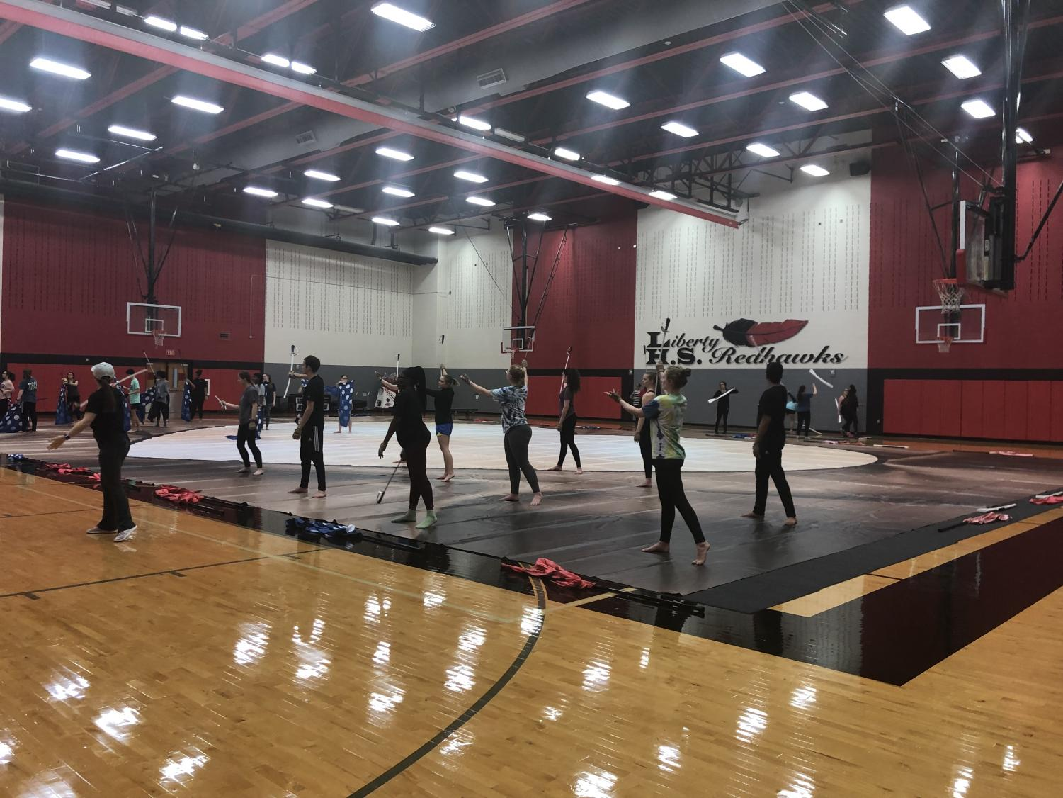 After weeks of competition, varsity winter guard is taking a break. The team looks forward to improving their performance styles.