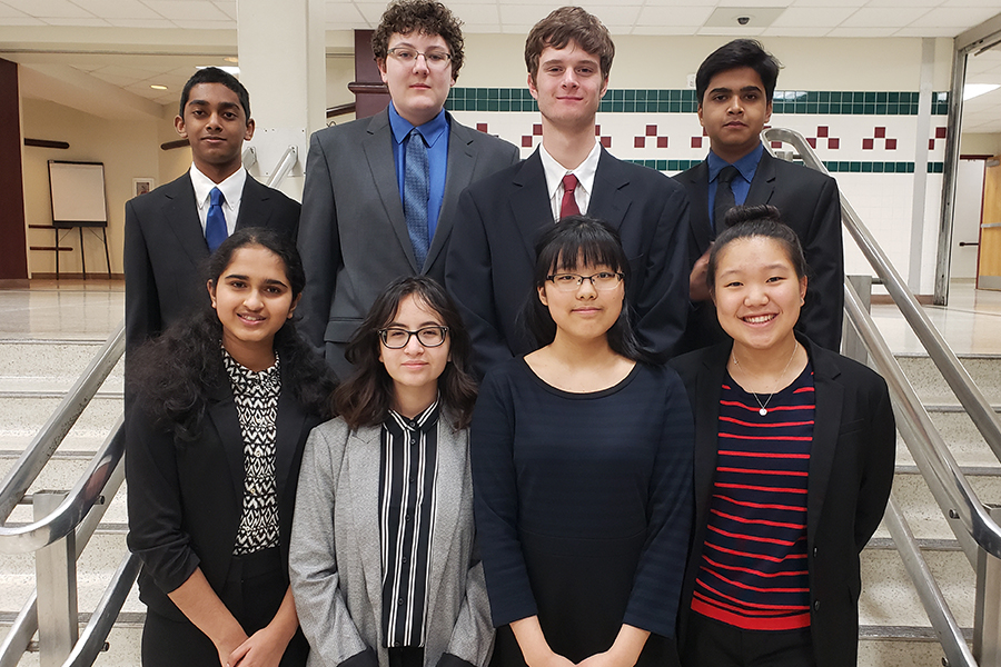 Junior Andrew Sen, sophomore Ethan Walker, junior Jackson Hawk, senior Nihar Degaonkar, sophomore Thrisha Malireddy, sophomore Sofia Calderon, sophomore Ella Gong, and junior Chelsea Kang pose for a picture at the Academic Decathlon region competition on Friday and Saturday at McKinney High School.
