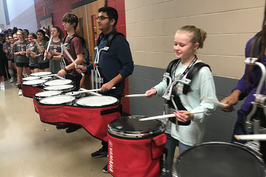 The band performed as the girls' were sent off to state in San Antonio.