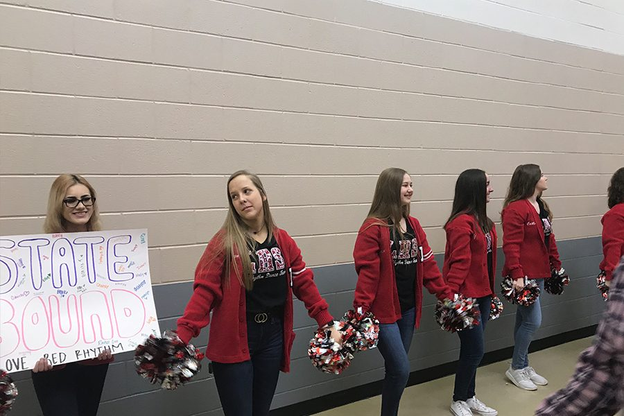 Red Rhythm dancers helped pump the girls' basketball team up as they were sent off to state on Thursday.