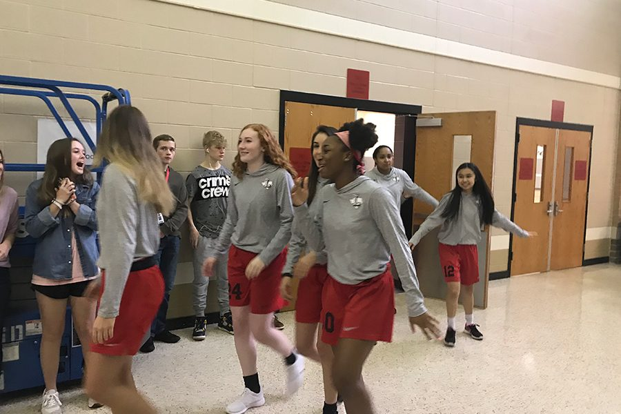Students across the campus hyped up the girls' basketball team as they headed off on the road to state in San Antonio.