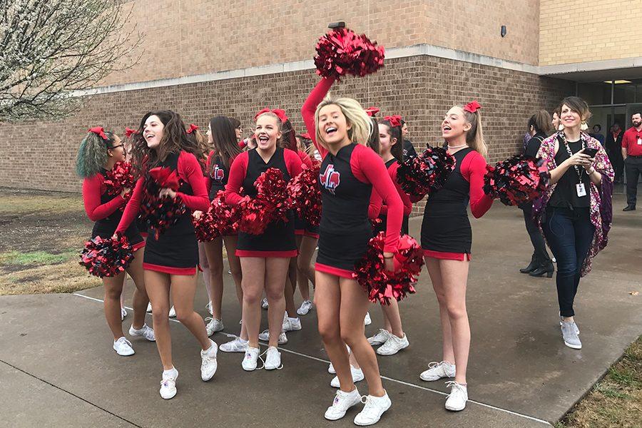 The school's cheerleaders sent off the Lady Redhawks to San Antonio and spread school spirit on Thursday morning.