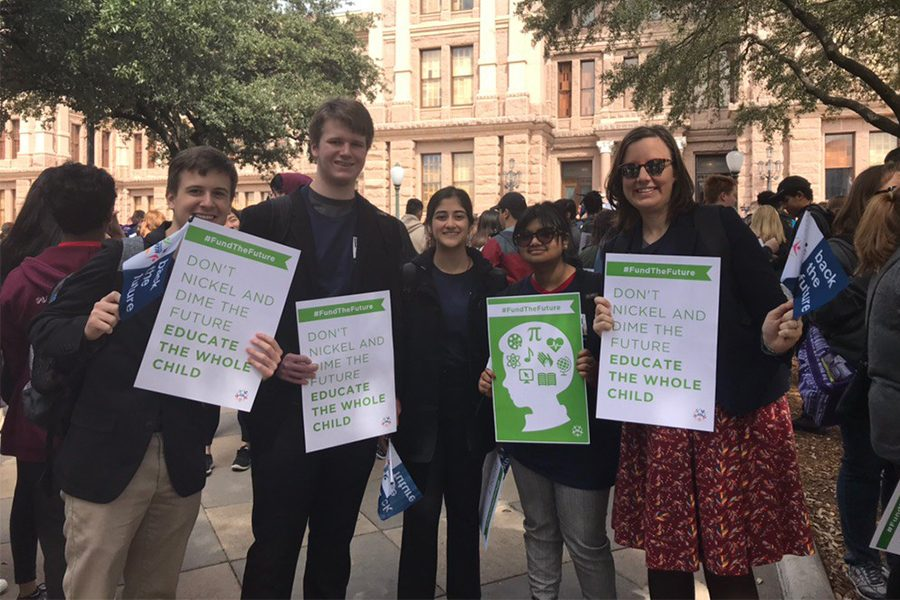 History+teacher+and+four+Redhawk+students+hold+signs+promoting+funding+solutions+at+the+rally.+The+Texas+PTA+then+spent+the+afternoon+meeting+and+asking+education+questions+with+legislators.