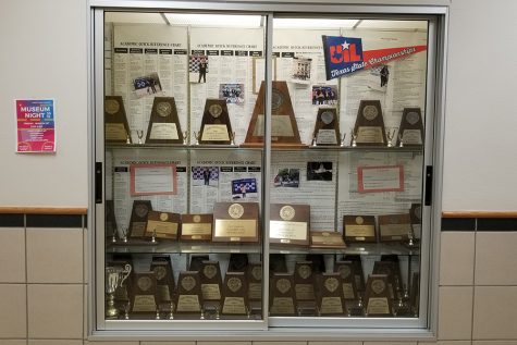 An award case displays the past accolades of the campus UIL Academics team including district titles and individual state awards. Redhawks placed 7th overall in this year