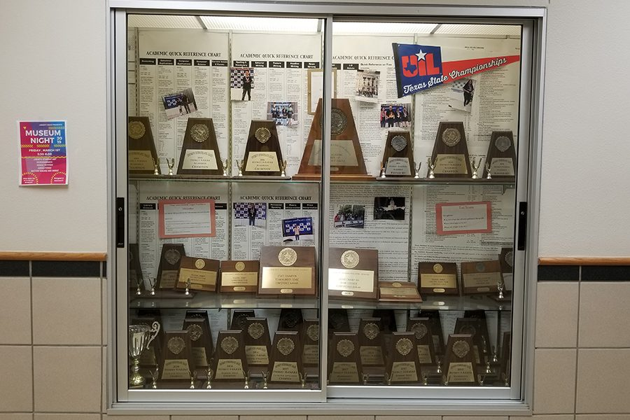 An award case displays the past accolades of the campus UIL Academics team including district titles and individual state awards. Redhawks placed 7th overall in this years 5A UIL Region II meet.