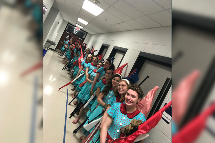 """Varsity winter guard is taking part in Saturday's Winter Guard International Dallas regional at Coppell High School. """"I want us to leave a strong impression,"""" senior Charlotte Mania said via text. """"I want people to look at us and be like, 'Wow that is THE Liberty color guard.' It doesn't matter what score we get as long as we [the team] feels good getting off the floor."""
