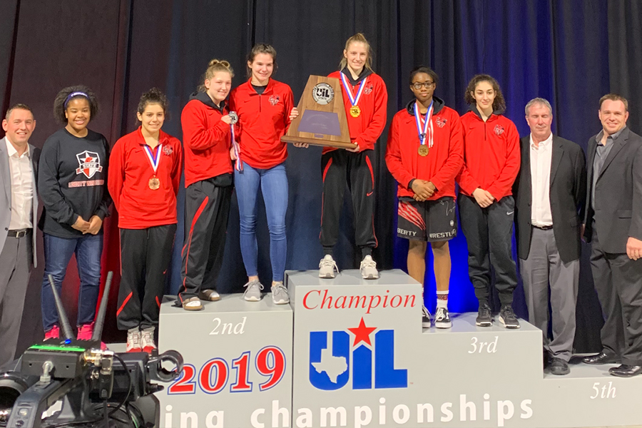 The+Redhawk+wrestlers+pose+for+a+picture+alongside+their+coaches+at+the+UIL+State+Championship+on+Friday+and+Saturday.