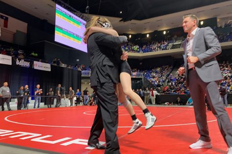 Wrestling grapples with powerhouse teams
