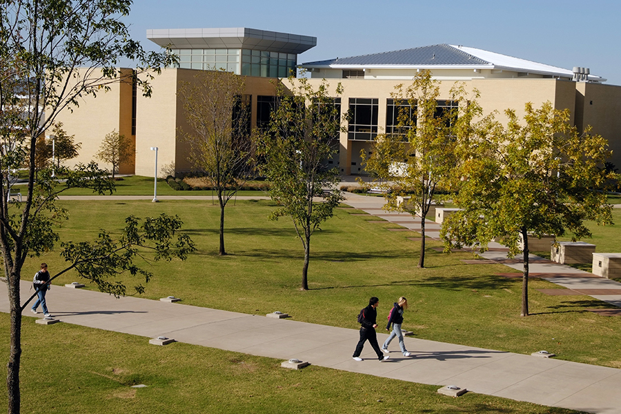 Students head to class at Collin College's Preston Ridge campus in Frisco. Fees for spring semester classes with the college are due Wednesday at 8 p.m.