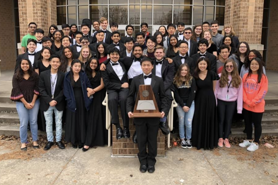 Following+their+Friday+performance+at+Centennial%2C+the+Redhawk+full+orchestra+stand+outside+the+campus+auditorium+with+their+sweepstakes+award.+The+top+group%27s+performance+concluded+a+week+of+UIL+contests+for+orchestra+that+began+Tuesday+Feb.+26.