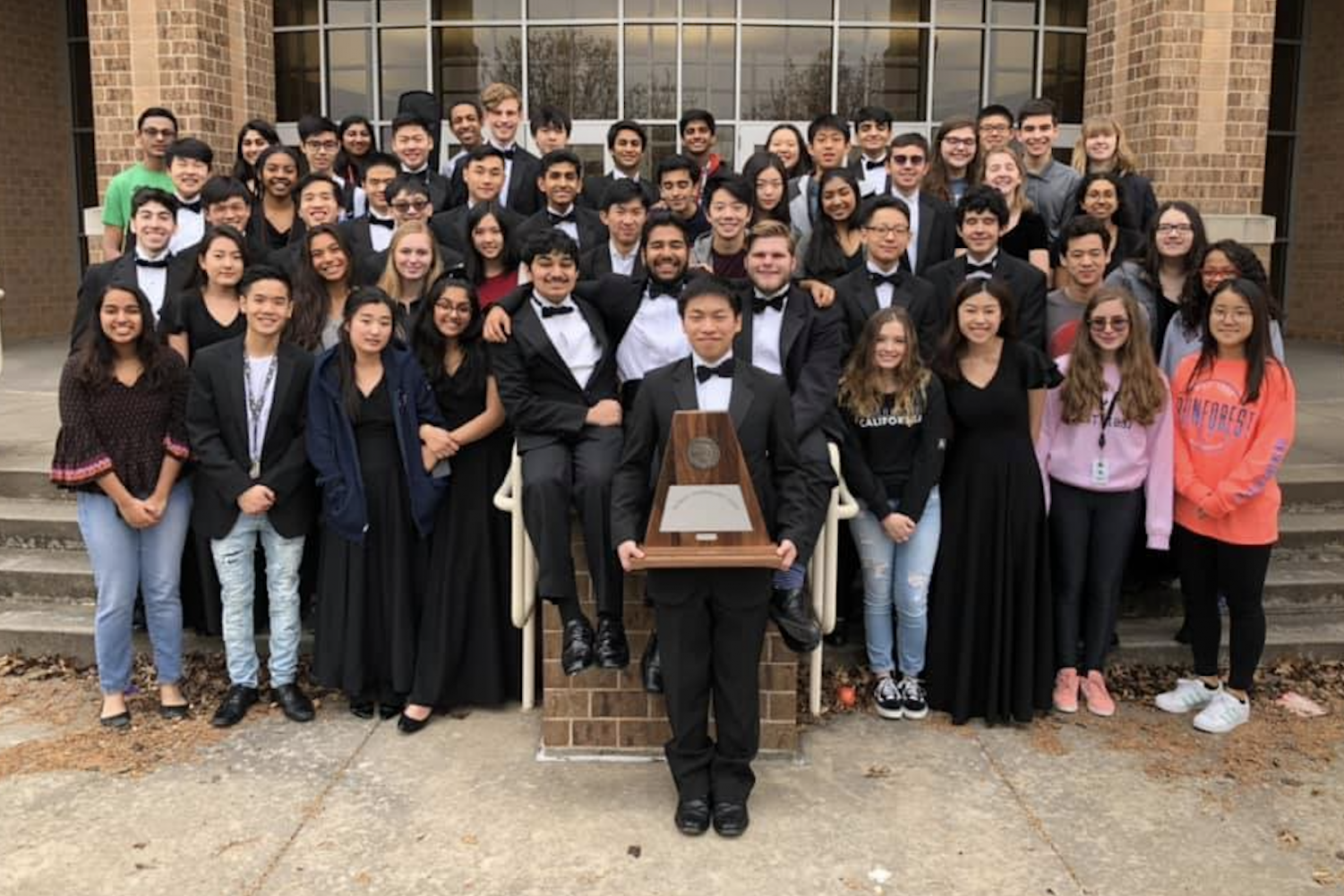 Following their Friday performance at Centennial, the Redhawk full orchestra stand outside the campus auditorium with their sweepstakes award. The top group's performance concluded a week of UIL contests for orchestra that began Tuesday Feb. 26.