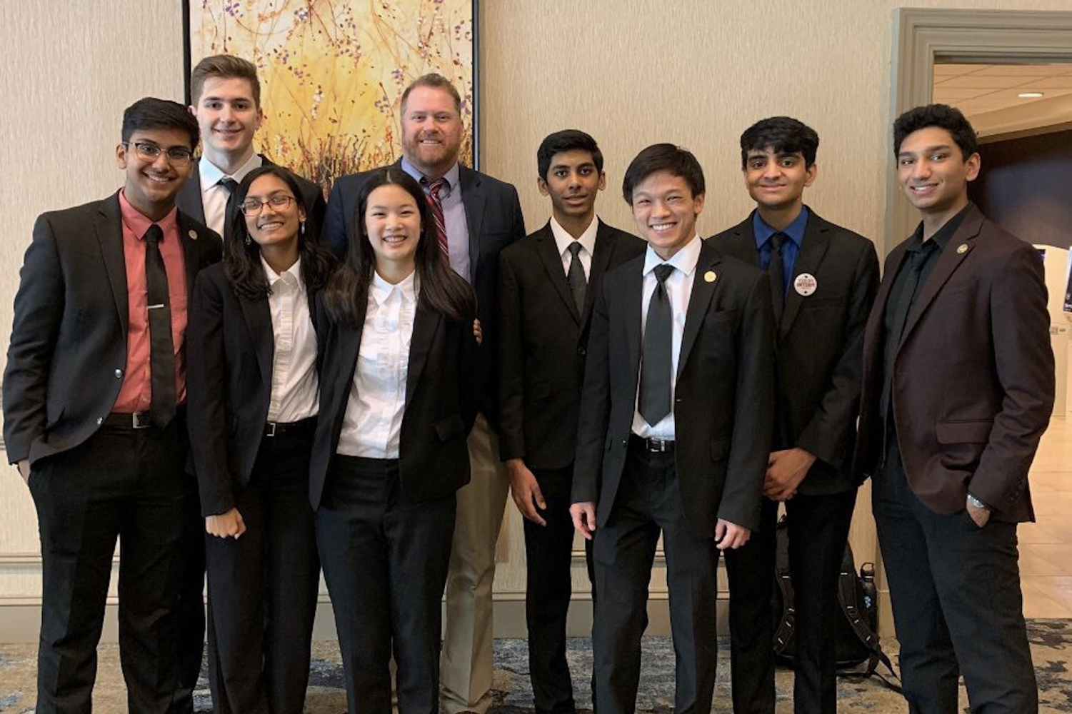 Nine Redhawks competing in the state BPA conference pose after contests concluded in Dallas the Saturday after school let out for spring break. Students Kapil Rampalli, Shunmathi Rajesh, and Nikhil Yerva will head to Anaheim in May having advanced to the national competition.