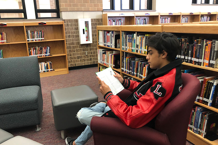 Mixing up his choice in reading, junior Jainam Manot participates in Speed Book Dating where he gets a glimpse of a few different books then chooses his favorite to continue reading.