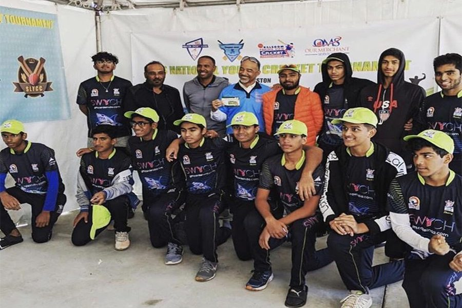 Prior to taking pitch of a cricket game, freshman Advik Dixit (bottom row, second from right) poses for a picture with his team as they prepare for the opening game in a tournament. Played by approximately 200,000 people in the United States, cricket is one of the most popular sports in India, Pakistan, and Bangladesh.